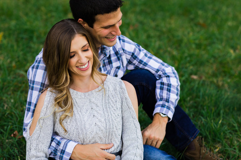 Maine Engagement Shoot with a laughing and intimate couple outdoors in the fall in a field in New Hampshire outdoors