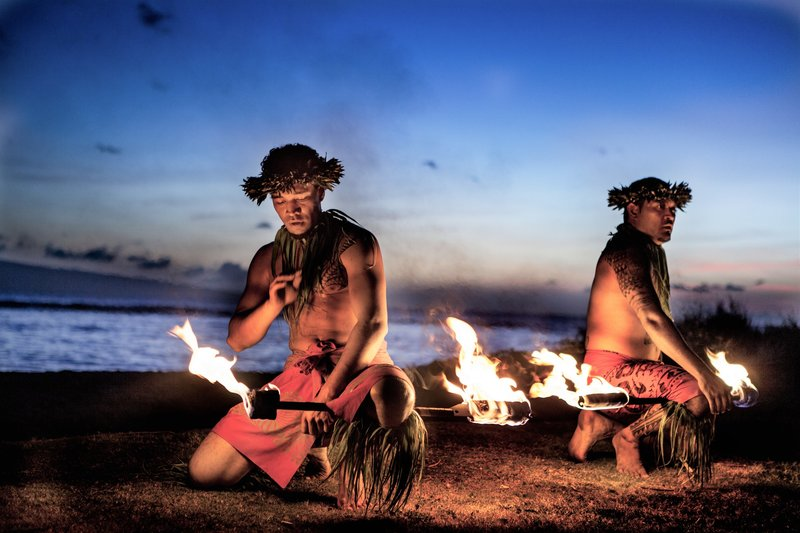 Two hawaiian fire dancers