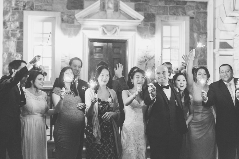 Wedding party holding sparklers at Graydon Hall