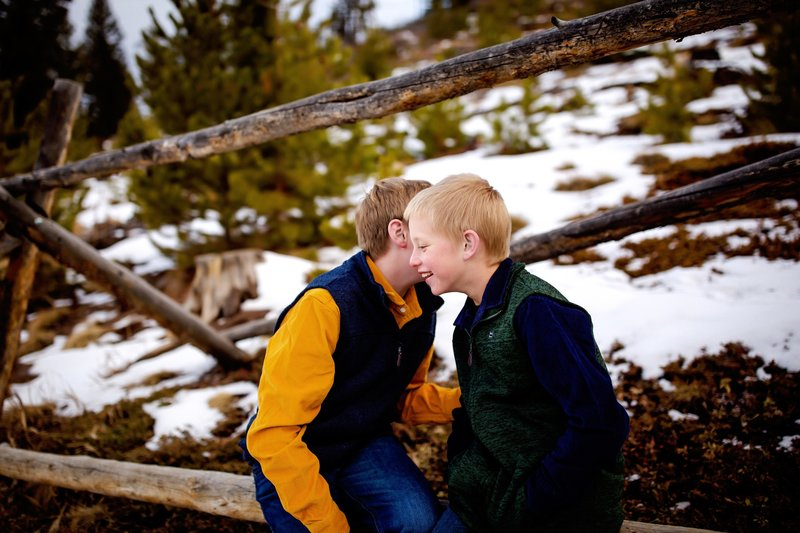 Brothers playing in the mountains Colorado