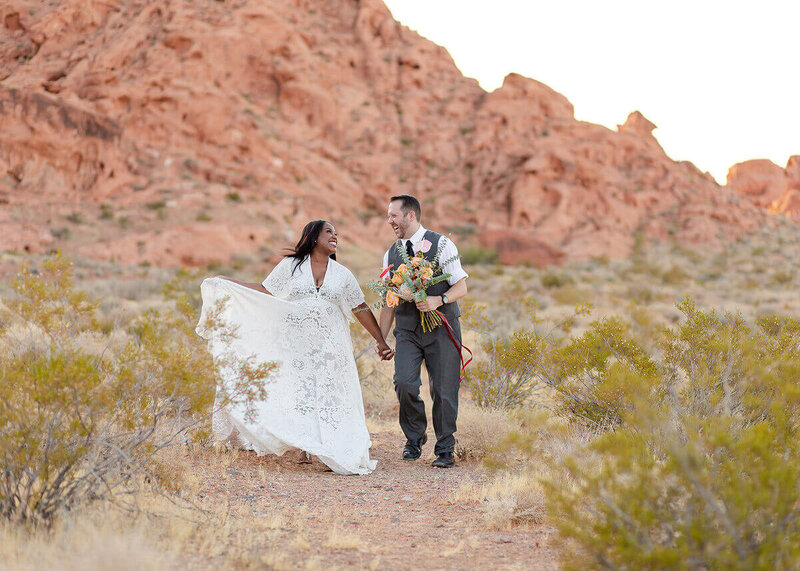 Couple walking with florals at the Valley of Fire Las Vegas