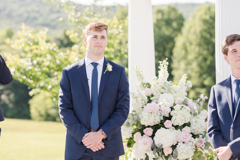 groom during ceremony at springfield manor winery and distillery wedding by costola photography