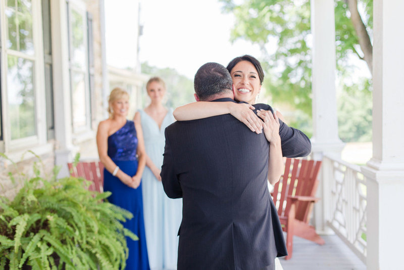 bride and father hug before wedding at springfield manor winery and distillery wedding by costola photography