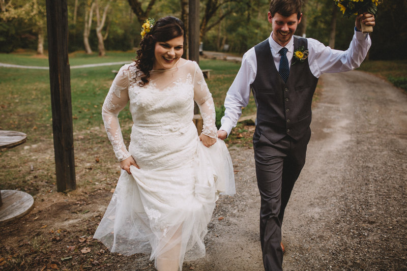 wedding couple walking down road