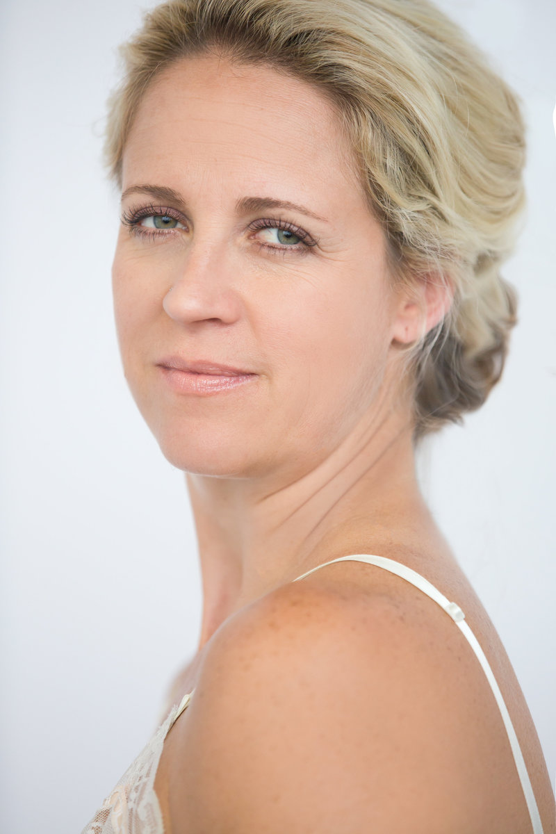 Light portrait of blonde woman on white background