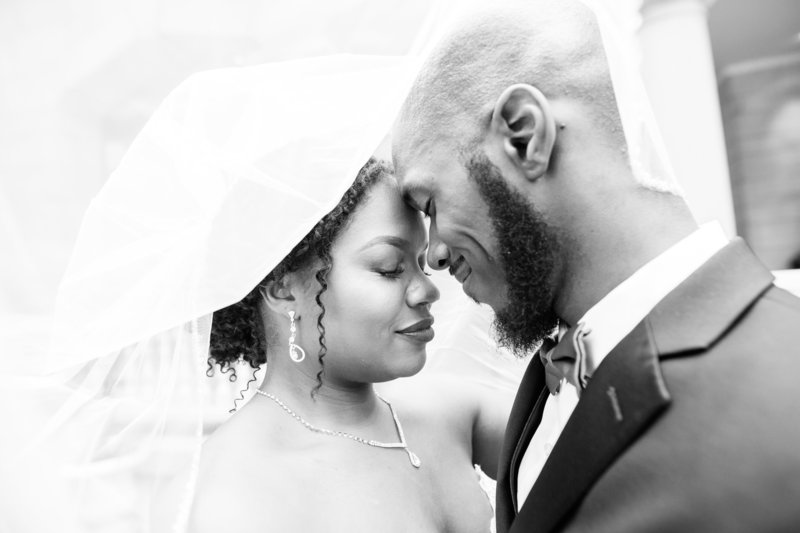 Black couple under the veil at their wedding at the Wimbish House in Atlanta Georgia by Jennifer Marie Studios, Atlanta light and airy wedding photographer.