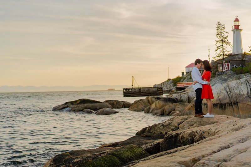 Couple holding each other for their Lighthouse engagement session