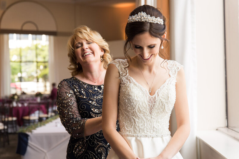 mom and daughter laughing on wedding day at cityflats ballroom port huron