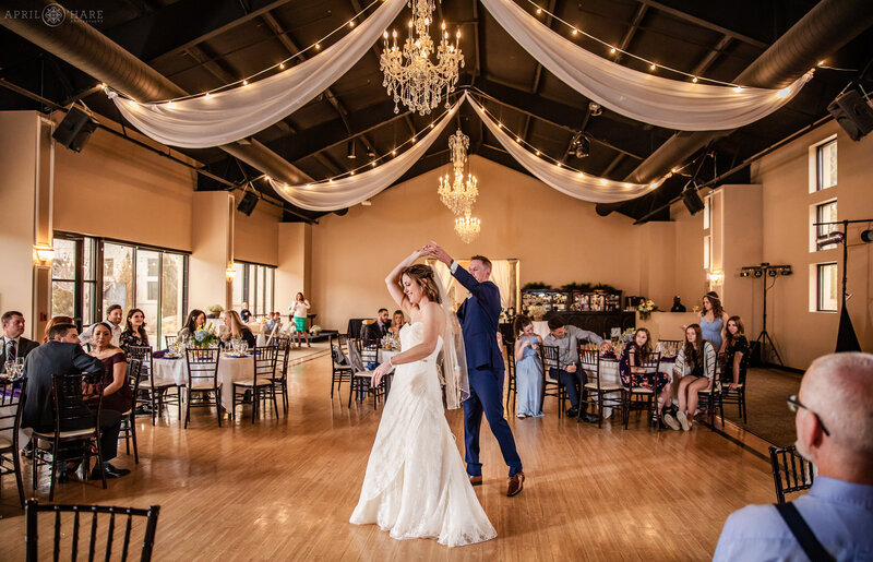 First dance in a modern ballroom in North Colorado Springs at Black Forest Wedgewood Weddings
