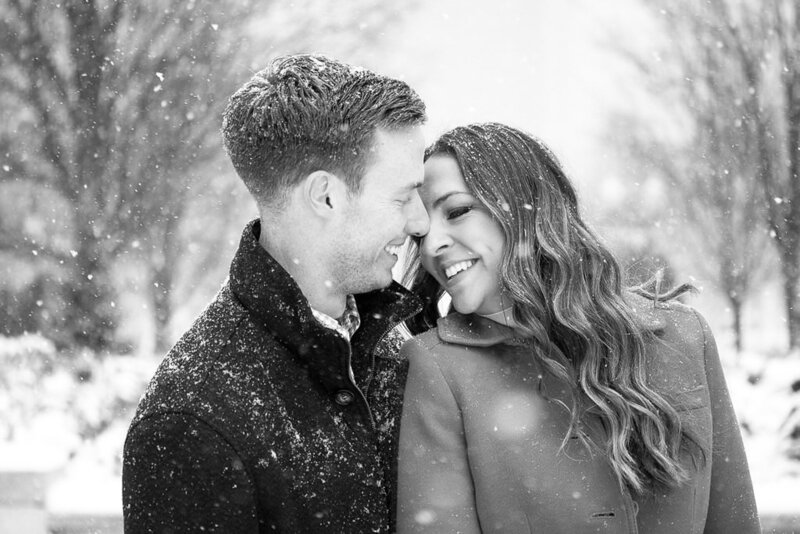 couple kiss snowy winter engagement session in Millennium Park Chicago