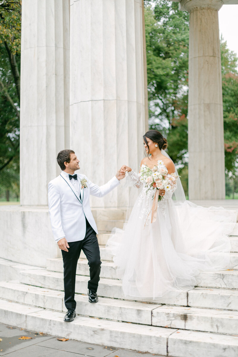 bride and groom walking down stairs at Washington DC Romantic Classic Wedding at the Lincoln Memorial by Costola Photography
