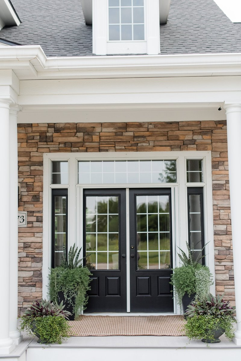 Front door planters in Grimes, Iowa by Red Fern Landscape Design