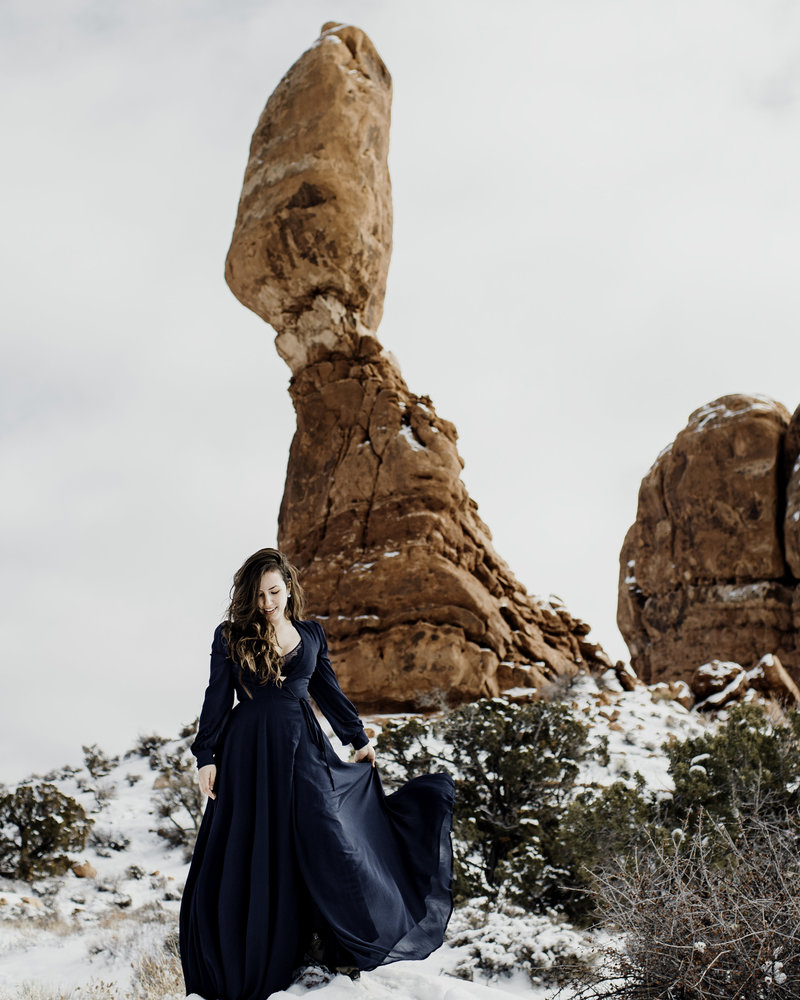 Self portrait in the snow at Arches National Park. Lulu long sleeves dress .