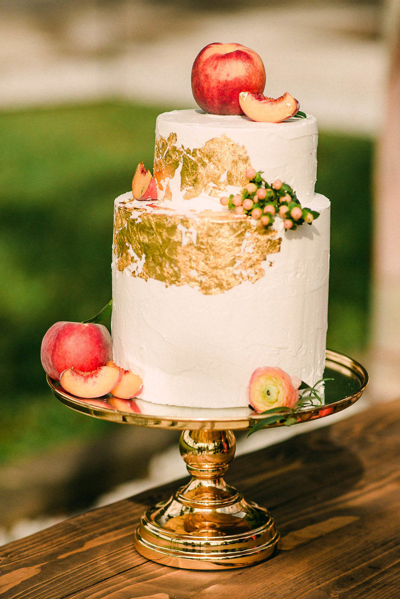 Peach and gold wedding cake at The Edison Barn Wedding