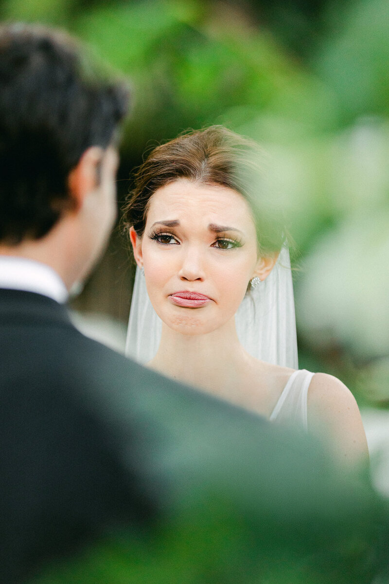 bride crying during wedding vows at ceremony