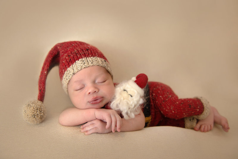santa themed christmas newborn studio session