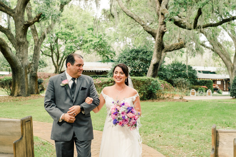 Emotional bride walks down the aisle with father at Club Lake Plantation