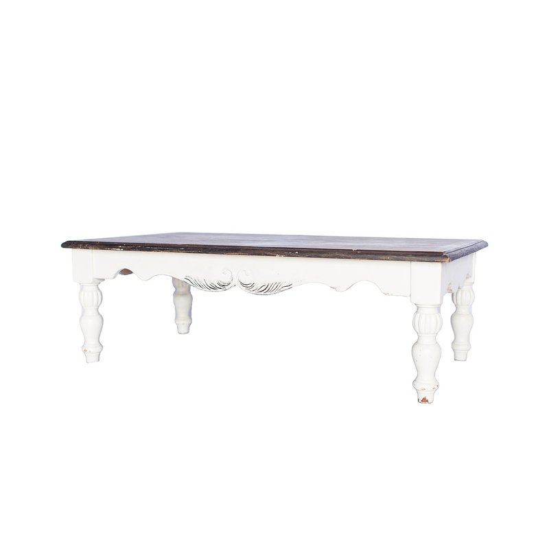 Large cream coffee table with a dark stained top.