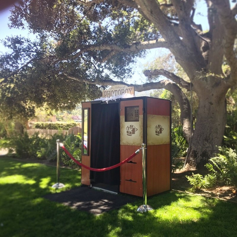 vintage photo booth next to a tree