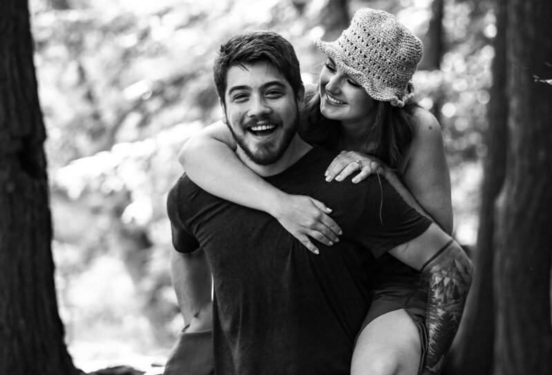 Man gives fiancee a piggyback ride at Wintergreen Gorge engagement photo session