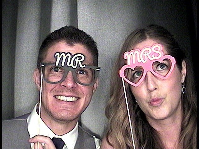 classic photo booth image with bride and groom