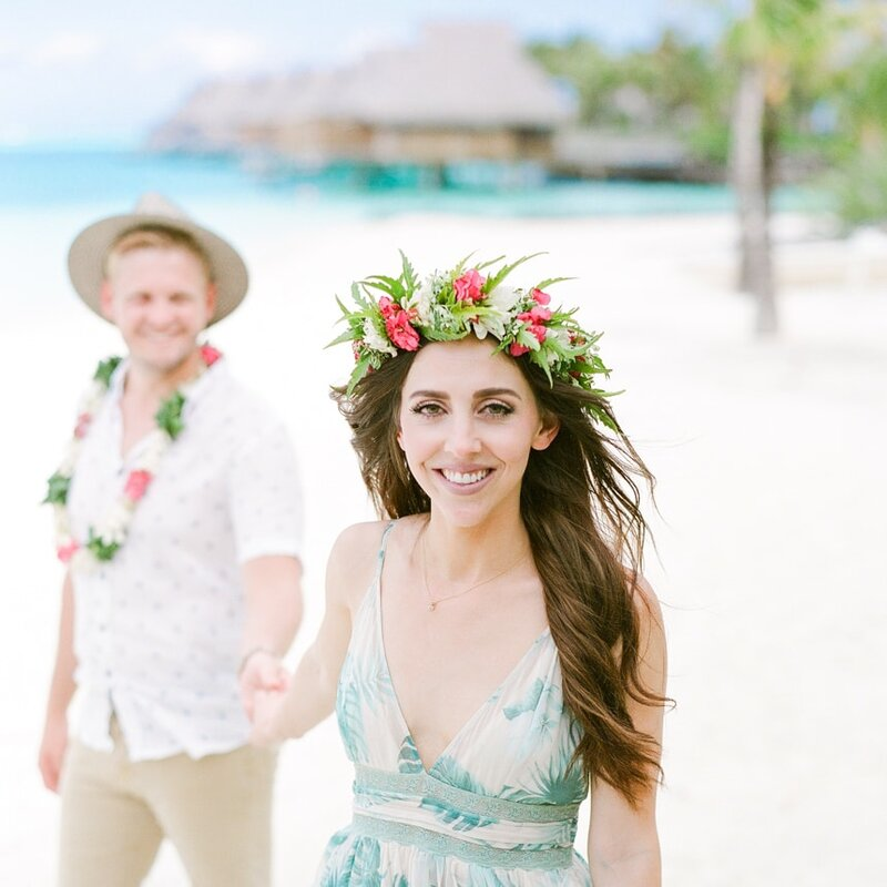 Portrait of Honeymooners in Moorea with flowers and elegant dress