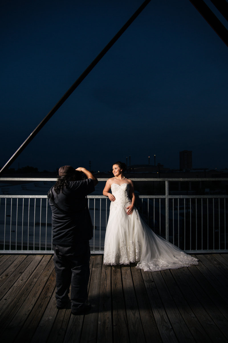 San Antonio Photographer David Castillo of Expose The Heart taking pictures of a bride at Hays Street Bridge