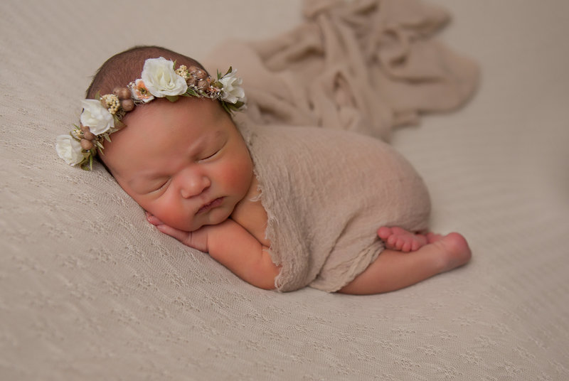 newborn girl with halo