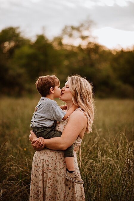 Pregnant mom and her toddler son kissing during our Vancouver Maternity photography session