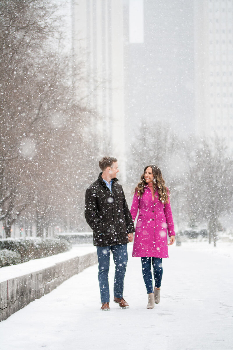couple walk in detroit snowstorm