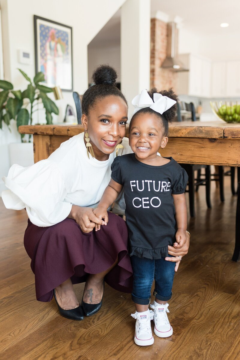 "black business owner with her daughter who is wearing a ""future ceo"" shirt in Nashville"