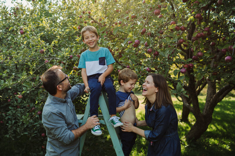 family in apple orchard