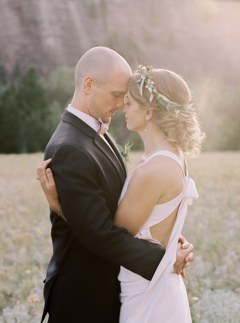 bride and groom hugging in montana field