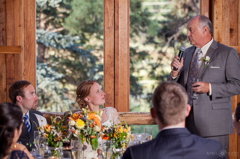 Wedding reception toasts inside the barn at Mountain View Ranch in Colorado