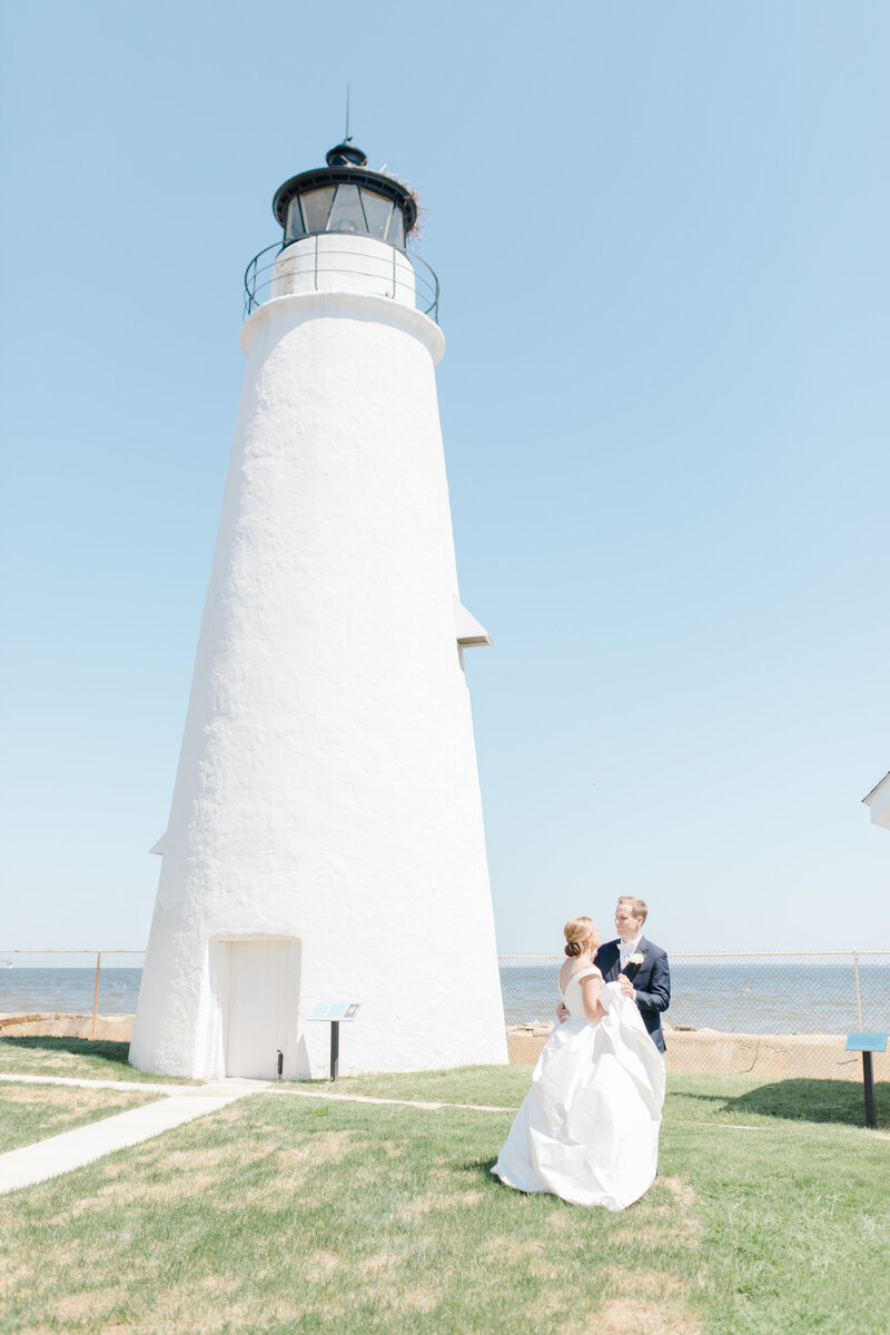 couple dancing under lighthouse at Inn at Perry Cabin wedding in St Michaels Maryland by Costola Photography