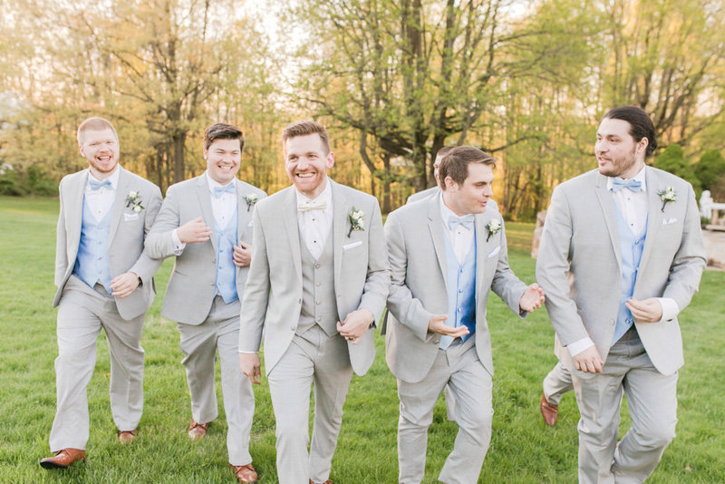 groomsmen walking in gray tuxes  at Stone House at Stirling Ridge Maryland Wedding by  Costola Photography
