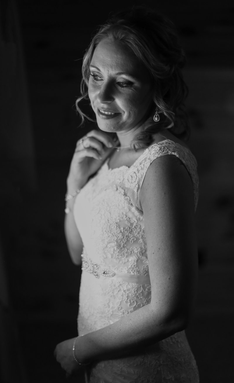 Solo portrait of a bride in her dressing room before her wedding in Erie, PA