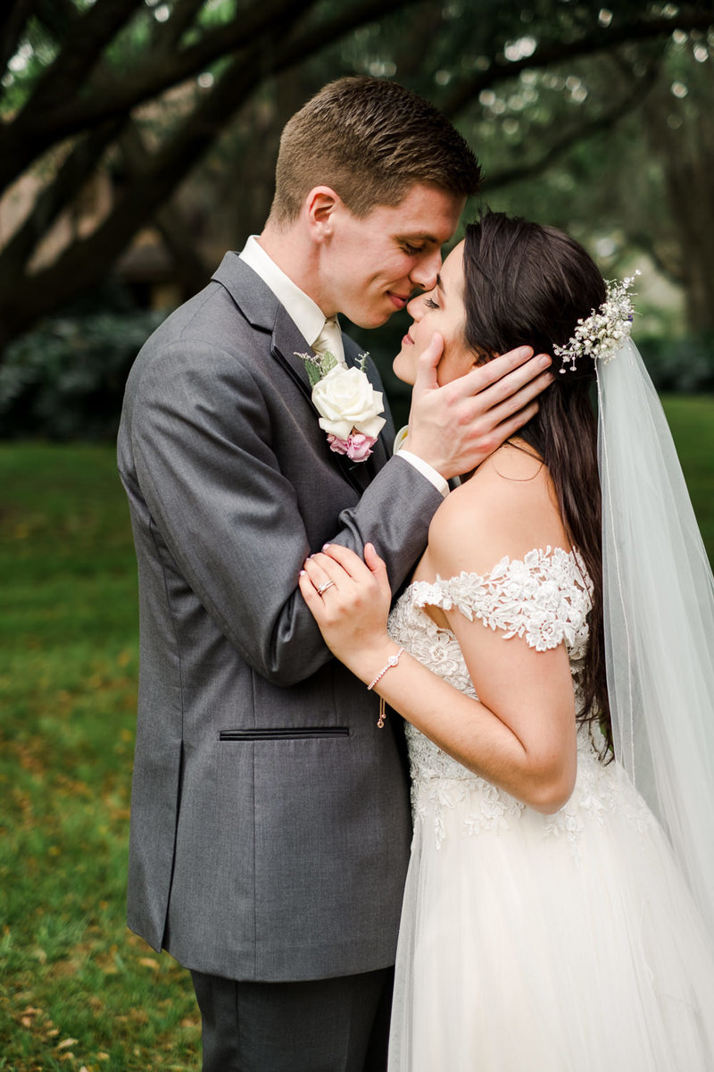 Groom holding bride's face in his hands at Club Lake Plantation Apopka FL