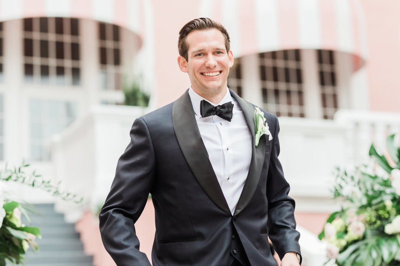 groom laughing at Don Cesar Wedding Photographer in St. Petersburgh Florida by Costola Photography