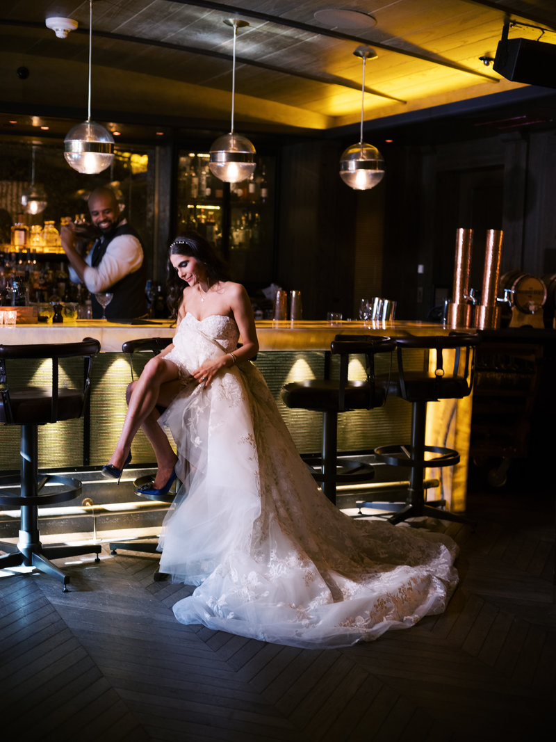 Bride sitting at bar in The Pendry Baltimore