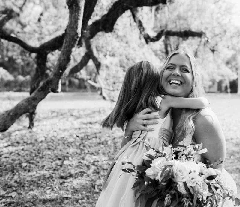 bride and little girl hugging