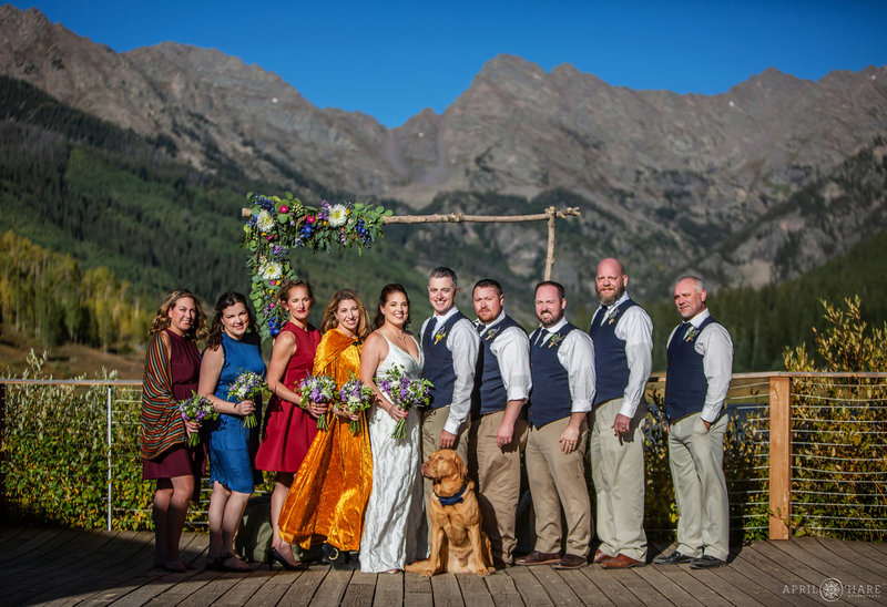 Sunny wedding day during fall at Piney River Ranch