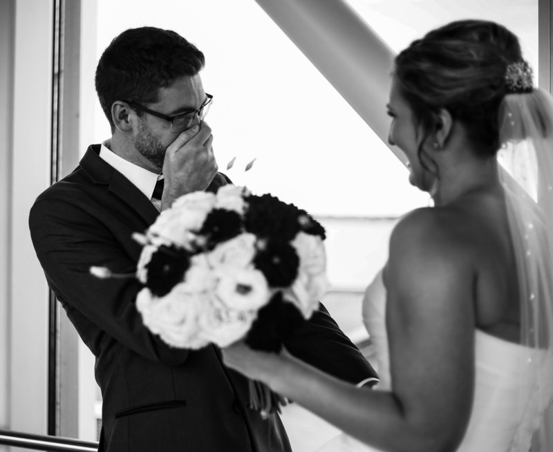 Groom reacts to seeing his bride during first look at the Sheraton Erie Bayfront Hotel