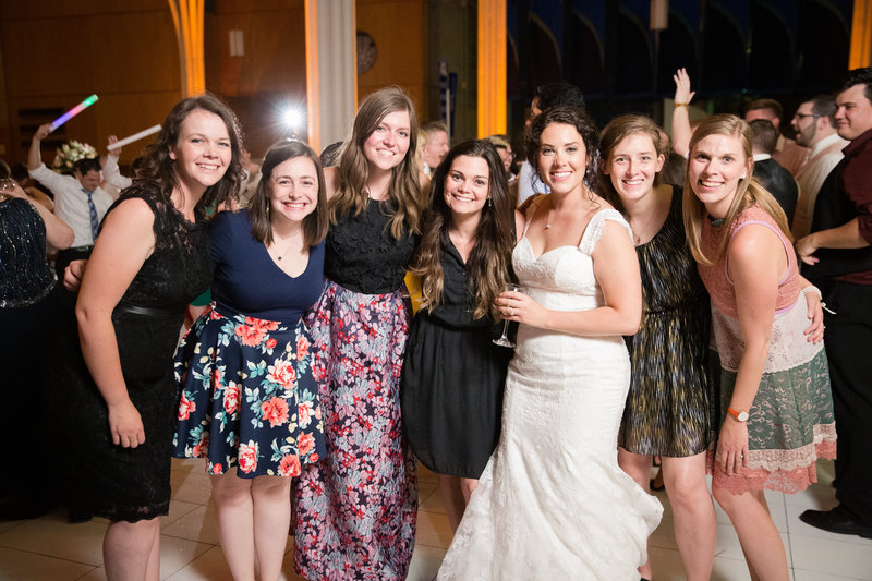 This is a group of happy Evangeline Renee brides all gathered at a wedding.