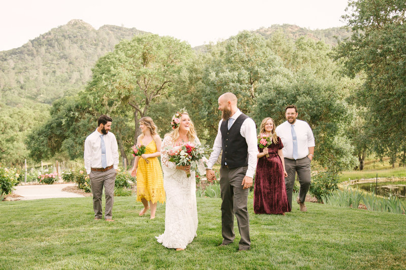 Bridal party laughs after wedding ceremony at Rancho Dos Amantes