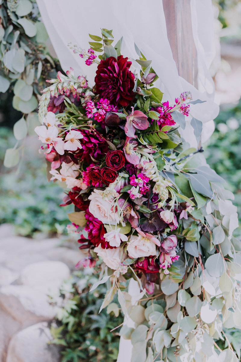 reno wedding photographers florals adorn arch