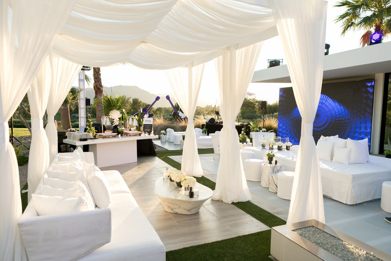 Luxuriously white draped outdoor 50th birthday party celebration set up