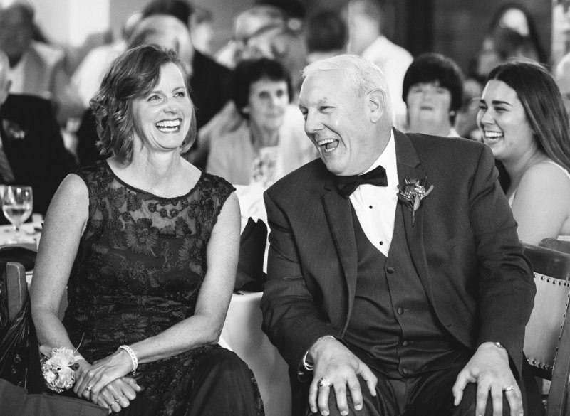 Parents of the bride laugh during the toasts at Masonic Temple wedding reception in Erie, PA