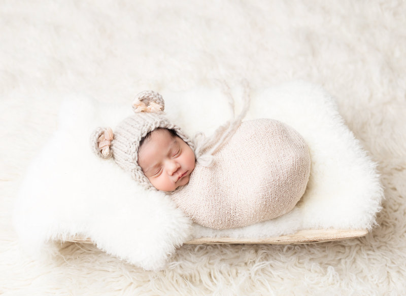Baby wrapped cream bear hat