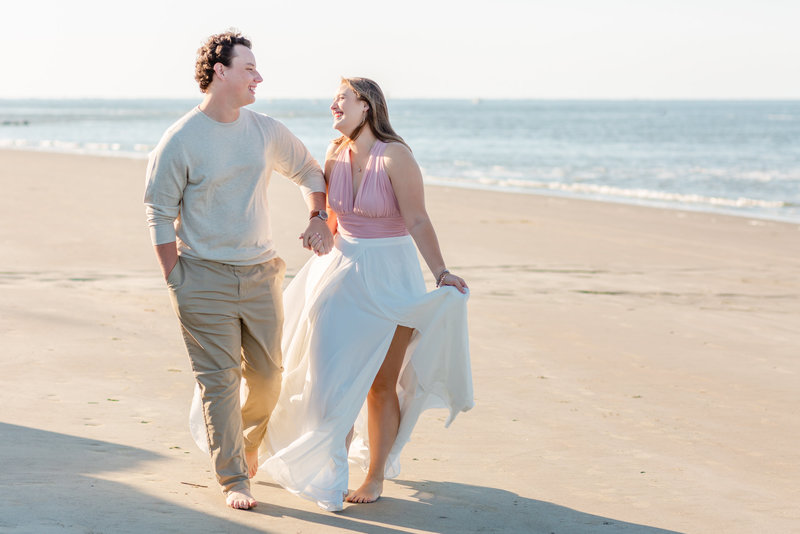 couple walking on the beach for their engagement session